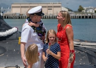 180330-N-LY160-0182 PEARL HARBOR, Hawaii (March 30, 2018) Chief Electronics Technician Nuclear Christopher Fendley, assigned to the Virginia-class fast-attack submarine USS Mississippi (SSN 782), greets his family during a homecoming ceremony in Joint Base Pearl Harbor-Hickam, March 30. Mississippi successfully completed a six-month Western Pacific deployment. (U.S. Navy photo by Mass Communication Specialist 2nd Class Michael H. Lee/ Released)