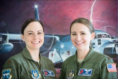 Maj. Devon Meister, pilot, and Maj. Ashley Lundry, aerial reconnaissance weather officer, are members of the 53rd Weather Reconnaissance Squadron, referred to as the Hurricane Hunters, which is a unit in the Air Force Reserve's 403rd Wing at Keesler Air Force Base, Mississippi. (U.S. Air Force photo by Staff Sgt. Heather Heiney)