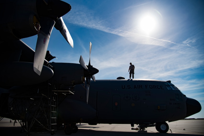 Senior Airman Even Campbell from the 911th Maintenance Squadron, based out of Pittsburgh International Airport Air Reserve Station, Pennsylvania, reviews the top of an HC-130P/N Combat King at Patrick Air Force Base, Florida, Mar. 1, 2018. The squadron is currently staged here to inspect their aircraft which are returning from overseas assignments, while their base readies for the transition to a new airframe. (U.S. Air Force photo/Staff Sgt. Jared Triamrchi)