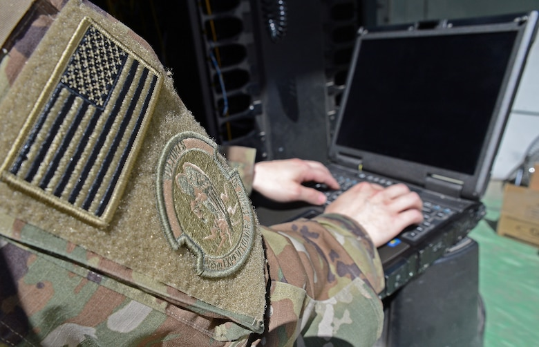 Staff Sgt. Brandon Hasegawa, 455th Expeditionary Communication Squadron cyber transport technician, activates a network port Mar. 22, 2018 at Bagram Airfield, Afghanistan.