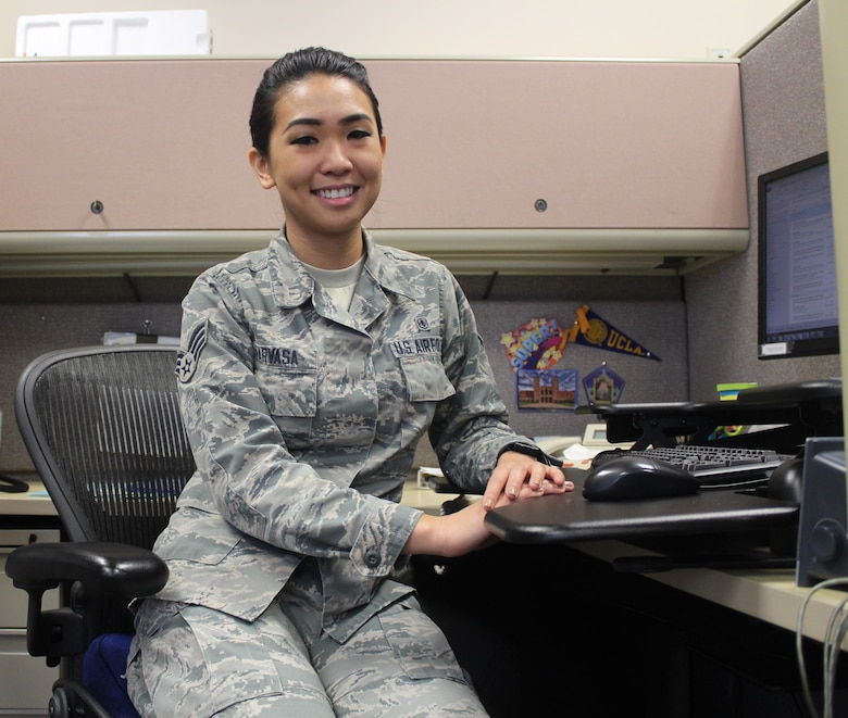 Senior Airman Nikki Narvasa, a health services management technician at the 88th Aerospace Medicine Squadron, flight and occupational medicine, graduated from UCLA receiving two bachelor degrees, one in Philosophy and the other in Labor and Workplace Studies. She received her MBA in International Business in April and has been accepted into law school. Narvasa plans to separate from the Air Force to attend law school and return as a judge advocate to help veterans and active duty members.  (U.S. Air Force Photo/Stacey Geiger)