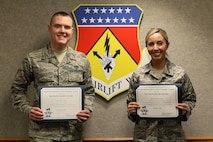 Senior Airman Jacob Dietz, 87th Aerial Port Squadron and Staff Sgt. Jessica Lang, 445th Aerospace Medical Squadron, display Diamond Sharp Awards they were presented April 7, 2018. Airman Dietz is the recipient of the February 2018 award and Sergeant Lang received the January 2018 award.