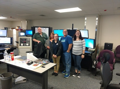 National Telecommunications Week is April 8-14, Each year, the second full week of April is dedicated to the men and women who serve as public safety telecommunicators. It was first conceived by Patricia Anderson of the Contra Costa County (Calif.) Pictured are some of Security Battalions own telecommunicators.