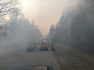 Fire and Emergency responders are shown as they control access to a wildfire at one of the many ranges throughout Marine Corps Base Quantico. This particular fire lasted two days of dedicated support from the fire department.