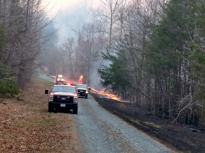 Shown here are Fire fighters conducting controlled burns in order to contain a range fire.
