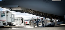 59th Medical Wing CCATT team members, in conjunction with mission partners, transition from their aircraft to an ambulance during an infant patient transport mission from Germany to Walter Reed National Medical Center, Bethesda, Md., April 19th, 2018. Examples of conditions requiring CCATT support include supportive or resuscitate care of shock/hemorrhage, respiratory failure, and multi-system trauma.  (U.S. Air Force photo by Senior Airman Keifer Bowes)