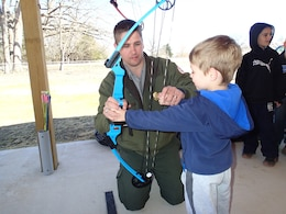 Devin Holt, Kansas City District park ranger at Pomme de Terre Lake, provides assistance during an archery clinic hosted at the Pomme de Terre Archery Range near Hermitage, Missouri.