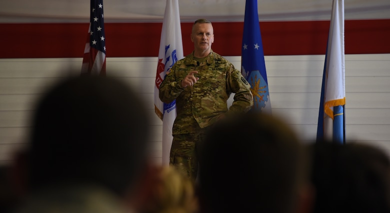U.S. Army Command Sgt. Maj. John Wayne Troxell, Senior Advisor to the Chairman of the Joint Chiefs of Staff, briefs an all-call.