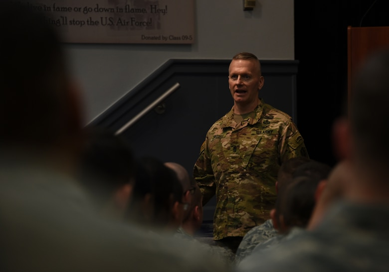 U.S. Army Command Sgt. Maj. John Wayne Troxell, Senior Advisor to the Chairman of the Joint Chiefs of Staff, briefs U.S. Air Force Airmen of the Paul W. Airey NCO Academy.