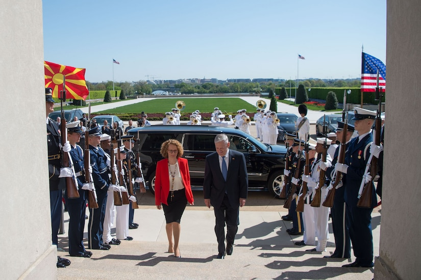 Defense Secretary James N. Mattis and the Macedonian defense minister walk up the steps of the Pentagon.