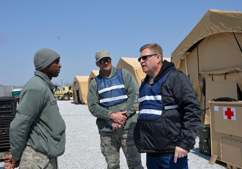 Jeff Brandenburg, chief, Air Forces Northern Medical Plans and Logistics, talks with Tech. Sgt. Quentin Richardson, 81st Medical Group Medical Support Squadron logistics, during the Expeditionary Medical Support field confirmation exercise here April 18. The confirmation exercise is evaluating the tactics, techniques and procedures of EMEDS operations during a domestic U.S. contingency such as a natural disaster. (Air Force photo by Mary McHale)