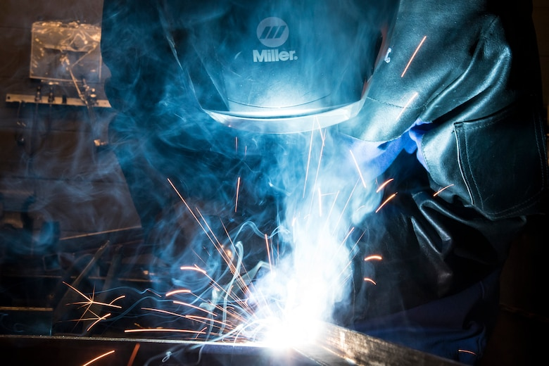 Airman 1st Class Isaiah Jackson, 23d Maintenance Squadron aircraft metals technology journeyman, welds components of a table, April 25, 2018, at Moody Air Force Base, Ga.  Metals technicians support the mission by utilizing fabrication techniques to repair and overhaul countless tools and aircraft parts. The technicians strive to exercise safe and precise fabrication techniques to be able to sufficiently handle their intense workload. (U.S. Air Force photo by Airman 1st Class Eugene Oliver)