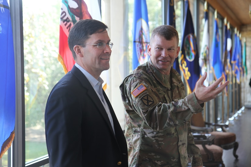 Army Lt. Gen. Jeffrey S. Buchanan, commander of U.S. Army North, speaks with Army Secretary Mark T. Esper at Fort Sam Houston, Texas.