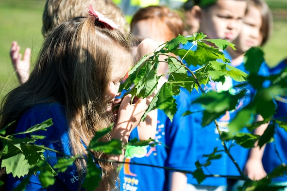 A child from Moody's child development center smells the leaf of an oak tree during Arbor Day, April 27, 2018, at Moody Air Force Base, Ga. Moody annually celebrates the holiday which encourages the benefits of planting trees. For 19 years the base has been a part of the Tree City USA Program by the National Arbor Day Foundation, to better prepare for the future of caring for their Airmen through improved ecological sustainability.  (U.S. Air Force photo by Airman 1st Class Erick Requadt)