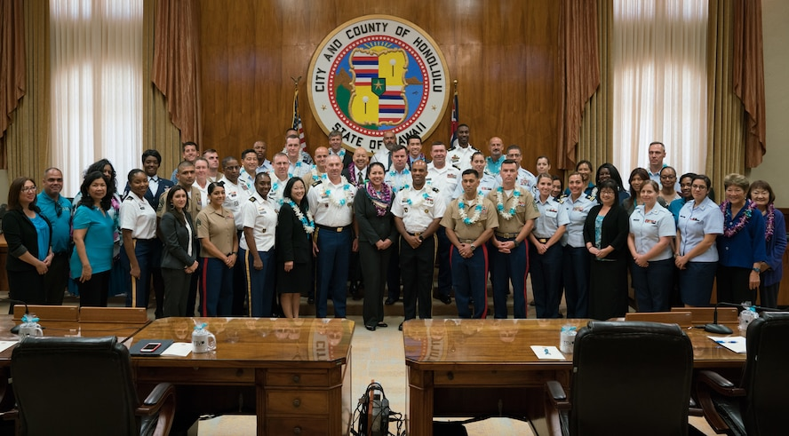Members of the Honolulu City Council, local service members and community action team members pose for a group photo during the Sexual Assault Awareness Month Proclamation Ceremony at Honolulu City Hall April 18, 2018.