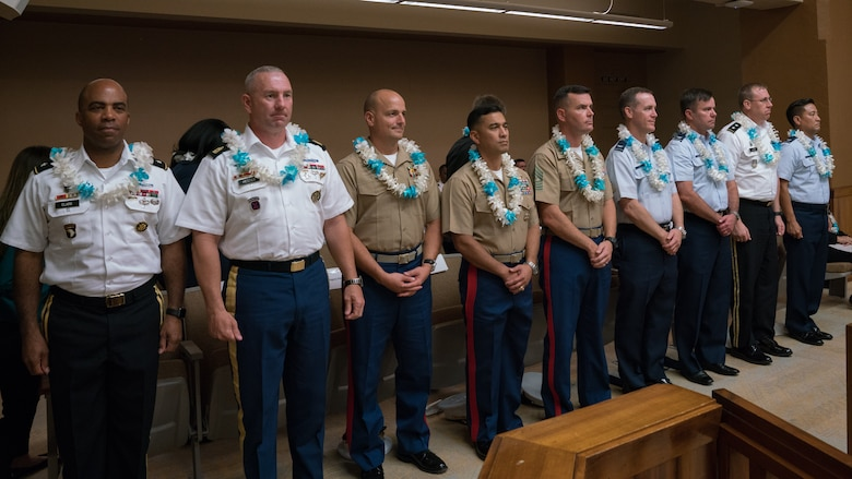 Military leaders from around Hawaii are presented with leis and thanked by community leaders at the Sexual Assault Awareness Month Proclamation Ceremony at Honolulu City Hall April 18, 2018.