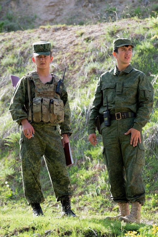 Lt. Azimov Farzod, company commander of the special company, Tajikistan Peacekeeping Battalion of the Mobile Forces, observes a traffic control point with Capt. Islomzoda Fakhriddin, commander, Tajikistan Peacekeeping Battalion of the Mobile Forces, at a mountain training camp outside of Dushanbe, Tajikistan, April 24, 2018, during an information exchange between Tajik and American forces. This information exchange was part of a larger military-to-military engagement taking place with the Tajikistan Peacekeeping Battalion of the Mobile Forces and the 648th Military Engagement Team, Georgia Army National Guard, involving border security tactics and techniques.