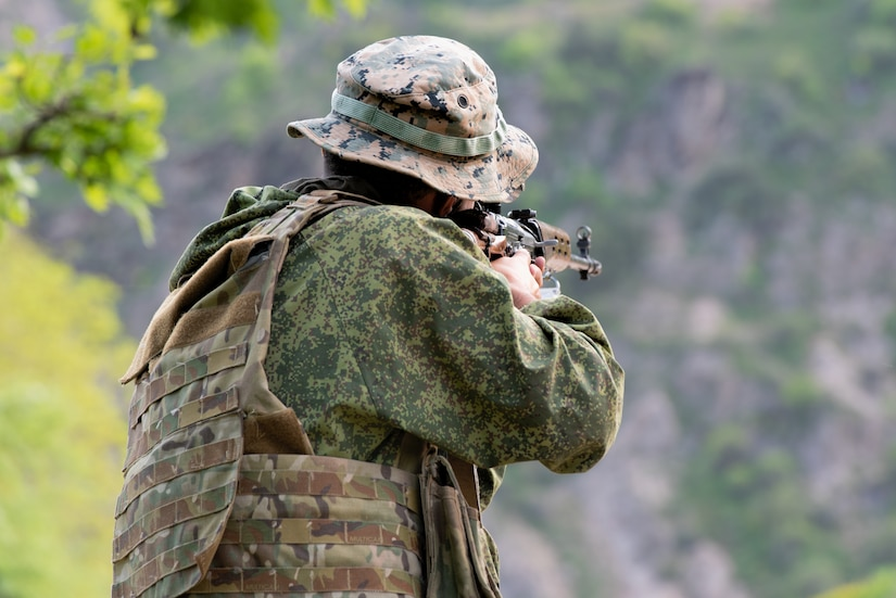 A Tajik soldier reacts to an ambush at a traffic control point at a mountain training camp outside of Dushanbe, Tajikistan, April 24, 2018, during an exercise to exchange tactics between Tajik and U.S. forces. This information exchange was part of a larger military-to-military engagement taking place with the Tajikistan Peacekeeping Battalion of the Mobile Forces and the 648th Military Engagement Team, Georgia Army National Guard, involving border security tactics and techniques.