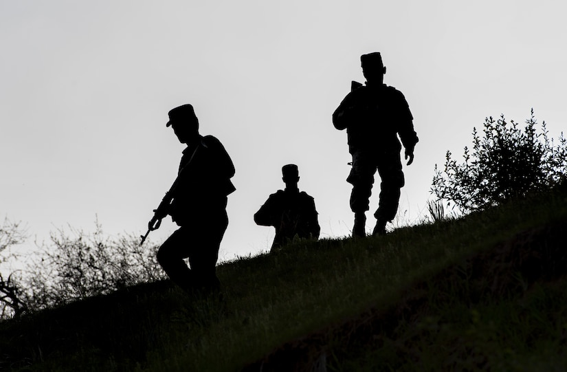 Tajik soldiers return from reacting to an ambush at a traffic control point at a mountain training camp outside of Dushanbe, Tajikistan, April 24, 2018, during an exercise to exchange tactics between Tajik and U.S. forces. This information exchange was part of a larger military-to-military engagement taking place with the Tajikistan Peacekeeping Battalion of the Mobile Forces and the 648th Military Engagement Team, Georgia Army National Guard, involving border security tactics and techniques.