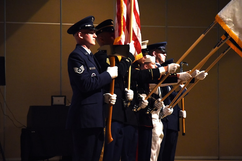 The Goodfellow Air Force Base Joint Color Guard, begin the ceremony for the 16th Annual Firefighter Ball, with a presentation of the colors at the McNease Convention Center, San Angelo, Texas, April 28, 2018. Department of Defense firefighters, friends and family were able to enjoy a meal and socialize during the event. (U.S. Air Force photo by Airman 1st Class Seraiah Hines/Released)