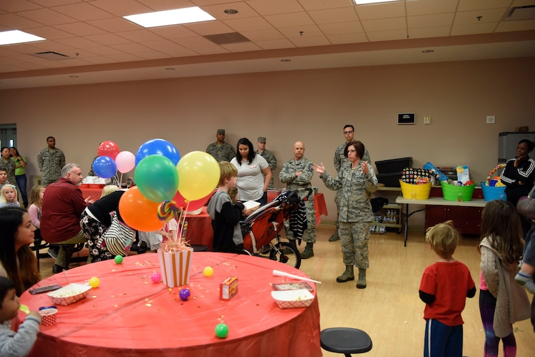 Col. Patricia Fowler, 436th Medical Group commander, provides opening remarks at the Deployed Families Dinner April 19, 2018, at Dover Air Force Base, Del. Nearly 50 family members of deployed Airmen attended the event. (U.S. Air Force photo by Airman 1st Class Zoe M. Wockenfuss)