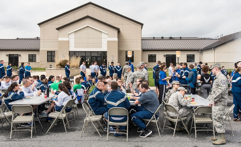 At the conclusion of the Wingman Day Amazing Race, Team Dover members are treated to hamburgers and hot dogs April 27, 2018, at the Base Chapel on Dover Air Force Base, Del. The Dover First Sergeant's Council cooked and served food to more than 400 individuals. (U.S. Air Force photo by Roland Balik)