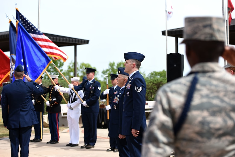 The Goodfellow Joint Service Color Guard posts the colors while Patriotic Blue vocalists sing the National Anthem to commence the Fallen Department of Defense Firefighter Memorial ceremony at the Firefighter Memorial on Goodfellow Air Force Base, Texas, April 27, 2018. The ceremony is held to honor fallen firefighters across the DoD. (U.S. Air Force photo by Airman 1st Class Seraiah Hines/Released)