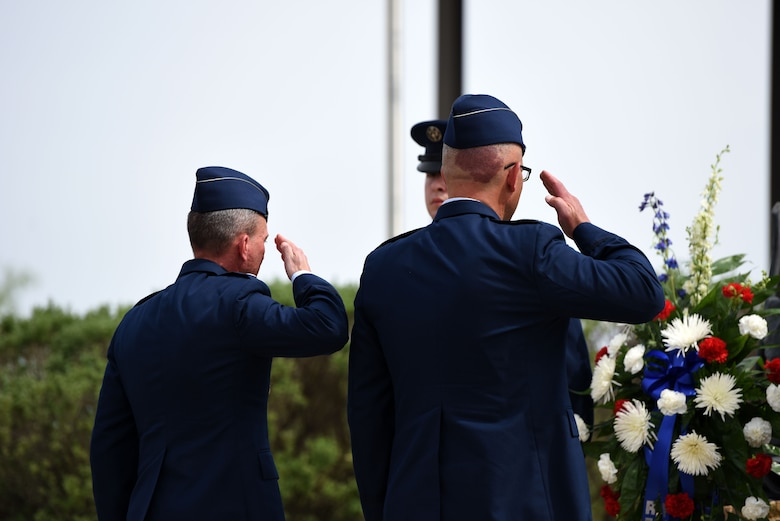 U.S. Air Force Lt. Col. Scott Cline, 312th Training Squadron commander, Col. Alex Ganster, 17th Training Group commander, salute after a wreath is placed on the memorial during the Fallen Department of Defense Firefighter Memorial ceremony on Goodfellow Air Force Base, Texas, April 27, 2018. Goodfellow and the Military Firefighter Heritage Foundation joined together to create the Firefighter Memorial in 2004. (U.S. Air Force photo by Airman 1st Class Seraiah Hines/Released)