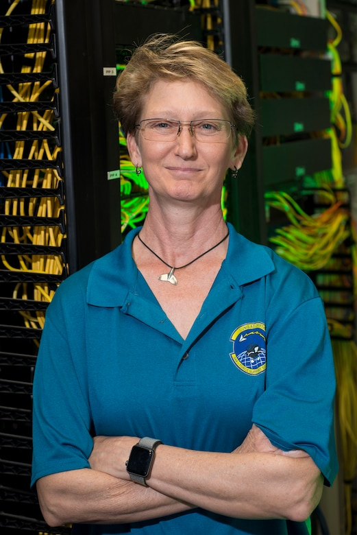 Fran Kramer, former 944th Fighter Wing network administrator, poses for a photo, April 12. Kramer served as the wing's first and main network administrator for the past 21 years.