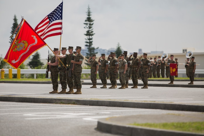 Marines with Combat Logistics Regiment 35, 3rd Marine Logistics Group, salute as the National Anthem plays during the regimental change of command ceremony May 1, 2018 at Camp Kinser, Okinawa, Japan. Col. Forrest C. Poole relinquished command of CLR-35 to Lt. Col. Kenric D. Stevenson. Poole is a native of Sharpesburg, Georgia. Stevenson is a native of DeRidder, Louisiana. (U.S. Marine Corps photo by Lance Cpl. Jamin M. Powell)