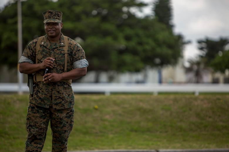 Lt. Col. Kenric D. Stevenson, commanding officer of Combat Logistics Regiment 35, thanks the Marines of CLR-35 for their efforts during the regimental change of command ceremony May 1, 2018 on Camp Kinser, Okinawa, Japan. Col. Forrest C. Poole relinquished command of CLR-35 to Stevenson. Stevenson is a native of DeRidder, Louisiana. (U.S. Marine Corps photo by Lance Cpl. Jamin M. Powell)