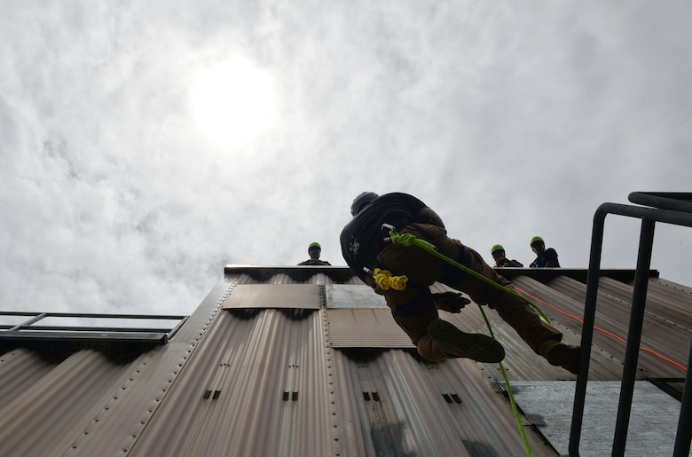 Tech. Sgt. Justin Andreas, 554th REDHORSE Squadron Fire Emergency Services Contingency Training instructor, demonstrates rapelling to students from the Republic of Korea Air Force April 22, 2018, at Andersen Air Force Base, Guam. The training took part during the routine Silver Flag, testing the U.S. and its partner nations on their capabilities to perform emergency services in all types of scenarios. (U.S. Air Force photo by Tech. Sgt. Jake M. Barreiro)