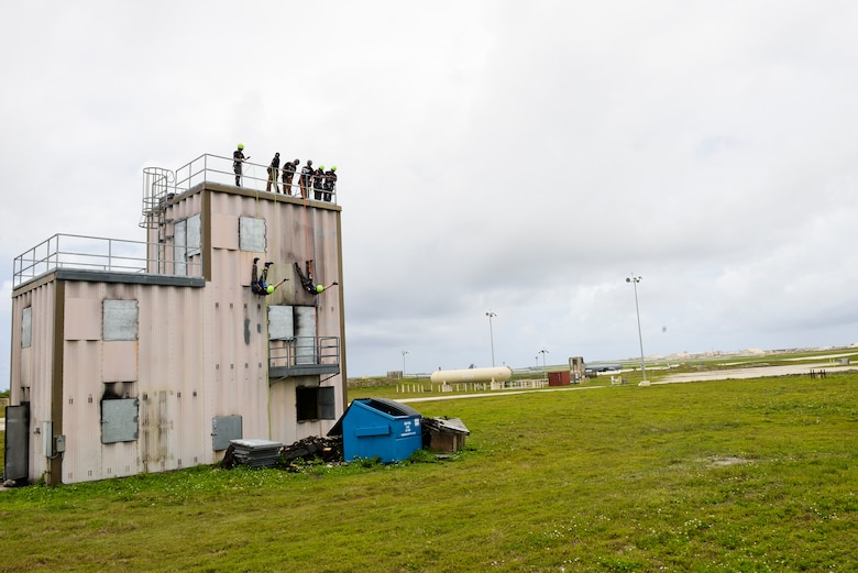 Airmen from the Republic of Korea demonstrate rapelling techniques during a training session April 21, 2018, at Andersen Air Base, Guam. The training, which took place during Theater Security Cooperative Silver Flag, simulates contingency training in a joint environment, testing Airmen from the Civil Engineer career field on their emergency preparedness. (U.S. Air Force photo by Tech. Sgt. Jake M. Barreiro)