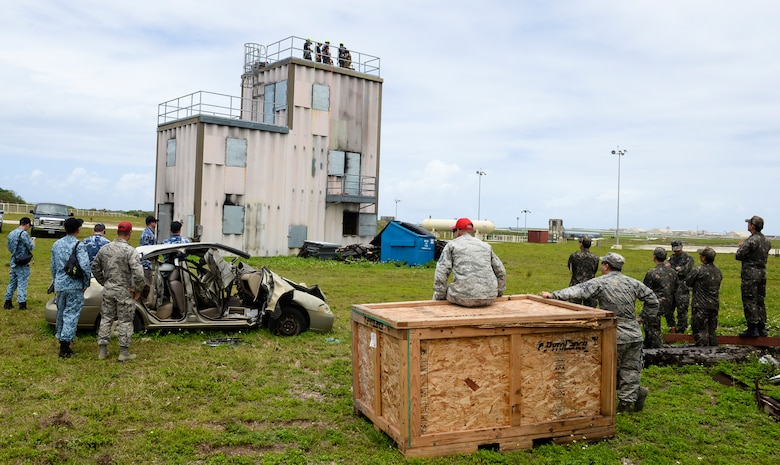 (From left to right) Observers from the Republic of Singapore, Australia, the United States, and the Republic of Korea, watch members of the ROK Air Force learn and demonstrate rapelling techniques April 22, 2018, at Andersen Air Force Base, Guam. All four partner nations combined their expertise for Silver Flag, a routine training exercise designed to test military civil engineers on their mission and contingency readiness. (U.S. Air Force photo by Tech. Sgt. Jake M. Barreiro)