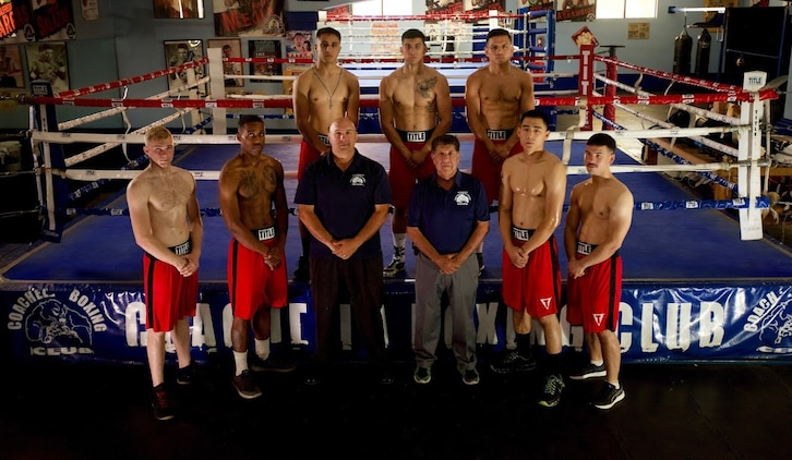 1st Marine Division Boxing Team poses for a group photo after a training session in Coachella, Calif.
