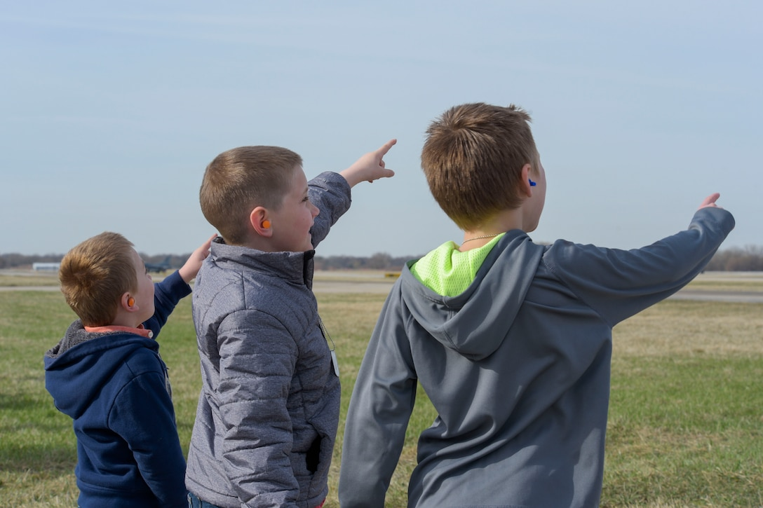 Charlie Nelson, 4, Mason Amoriello, 7, and Carter Coenen, 6, watch an F-16 Fighting Falcon takeoff at Truax Field, Wis. April 26, 2018. The takeoff was one of the many things children were able to participate in during National Take Our Sons and Daughters to Work Day. (U.S. Air National Guard photo by Cameron R. Lewis)