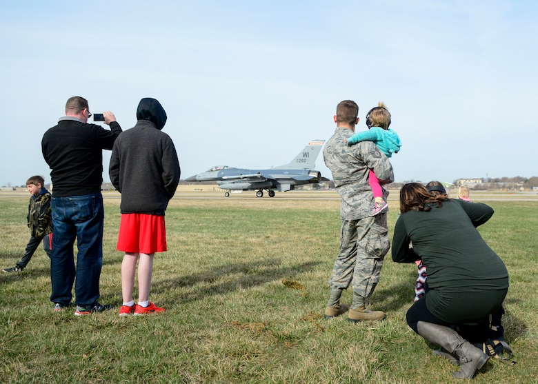 Airmen and their families watch as an F-16 Fighting Falcon prepares for takeoff April 26, 2018 at Truax Field, Wis. This was one of many demonstrations put on by the 115th Fighter Wing for National Take Our Daughters and Sons to Work Day.