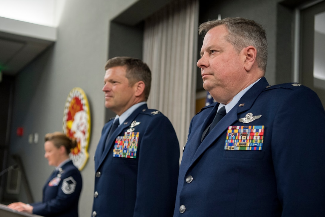 Col. Brian Hollis, 434th Operational Support Squadron commander, right, stands beside Col. Paul Gates, 434th Air Refueling Wing vice commander, during a promotion ceremony at Grissom Air Reserve Base, Ind., April 7, 2018. Before taking command of the 434th OSS, Hollis held numerous jobs within the 434th ARW, including tanker scheduler, nuclear plans officer, assistant chief pilot tactics officer, chief of mission development, chief of plans and director of operations. (U.S. Air Force photo/Tech. Sgt. Benjamin Mota)