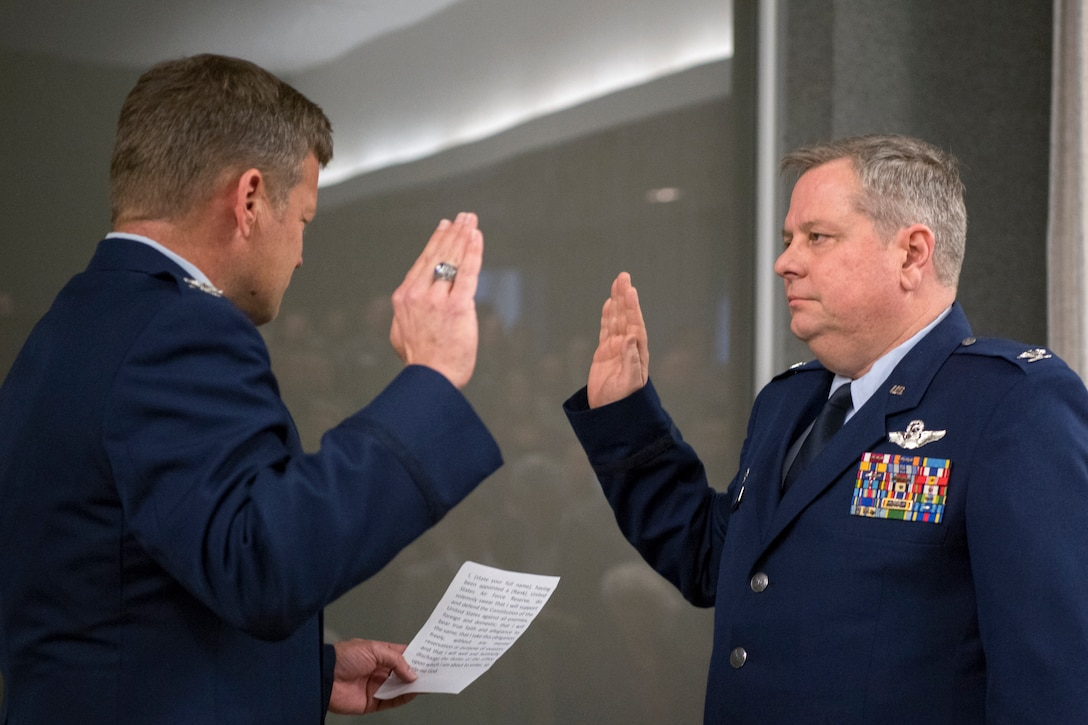 Col. Paul Gates, 434th Air Refueling Wing vice commander, left, administers the oath of office to Col. Brian Hollis, 434th Operational Support Squadron commander, during Hollis' promotion ceremony at Grissom Air Reserve Base, Ind., April 7, 2018. Hollis is among one percent of Air Force officers who make the rank of colonel during their military career. (U.S. Air Force photo/Tech. Sgt. Benjamin Mota)