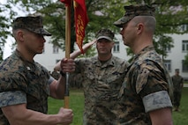 U.S. Marine Capt. Brett Yoder, on coming commander of Headquarters Company, Marine Forces Europe and Africa, receives the unit colors from Capt. Chronis, off going, during a MARFOREURAF change of command ceremony on Panzer Kaserne, Stuttgart, Germany, May 1, 2018. The passing of the unit guidon traditionally symbolizes the transfer of responsibility, authority, and accountability for the command by the outgoing commander to the incoming commander. (U.S. Marine Corps photo by Sgt. Averi Coppa/Released)