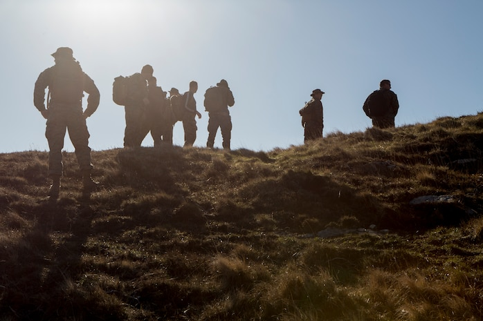 Marines and sailors with 4th Air Naval Gunfire Liaison Company, Force Headquarters Group, pause at the top of a hill to check their azimuth during a land navigation exercise in Durness, Scotland, April 30, 2018. 4th ANGLICO is in Scotland to take part in Joint Warrior 18-1, an exercise that furthers their readiness and effectiveness in combined arms integration, small unit tactics and land navigation. This training aims at improving their capabilities and combat effectiveness and ensures they're ready to fight tonight.