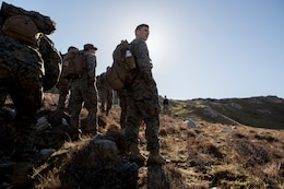 Sgt. Michael Peers, a firepower control team chief with 4th Air Naval Gunfire Liaison Company, Force Headquarters Group, pauses to check which direction his FCT plan on going during a land navigation exercise, in Durness, Scotland, April 30, 2018. 4th ANGLICO is in Scotland to take part in Joint Warrior 18-1, an exercise that furthers their readiness and effectiveness in combined arms integration, small unit tactics and land navigation. This training aims at improving their capabilities and combat effectiveness and ensures they're ready to fight tonight.