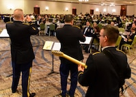 The U.S. Army 392nd Army Band Jazz Combo performs music medleys at the Fort Eustis 100th Anniversary Gala in Newport News, Virginia, April 28, 2018. Gala attendees continued the celebration with a cake cutting ceremony and a video presentation. (U.S. Air Force photo by Airman 1st Class Monica Roybal)