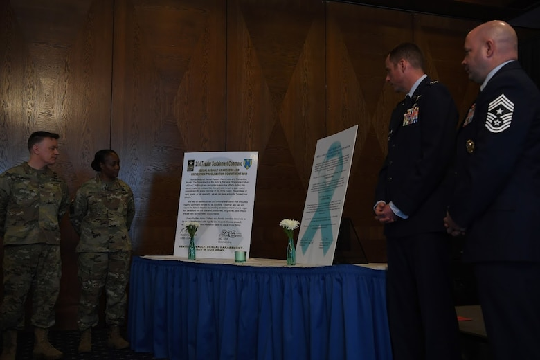 Leadership from the U.S. Army 21st Theater Sustainment Brigade and U.S. Air Force 86th Airlift Wing review the Sexual Assault Awareness and Prevention Month proclamation at Ramstein Air Base, April 12, 2018.