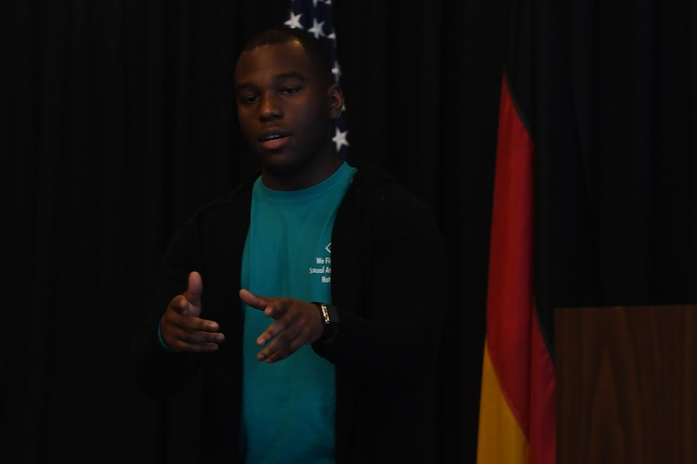 """U.S. Air Force Staff Sgt. George Linen, 786th Civil Engineer Squadron electrical systems supervisor and sexual assault survivor, performs an original poem called """"Speak"""" during the Sexual Assault Prevention and Response Leadership Breakfast at Ramstein Air Base, April 12, 2018."""