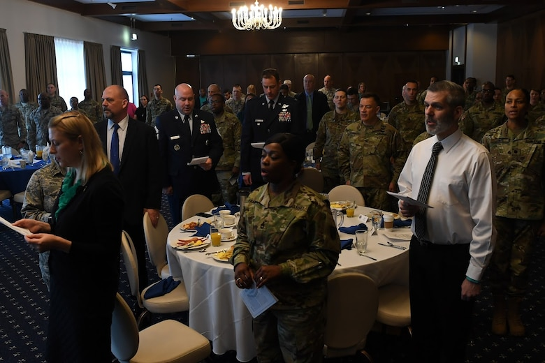 Leadership from the 86th Airlift Wing and 21st Theater Sustainment Brigade sing the U.S. Army and Air Force songs during the Sexual Assault Prevention and Response Leadership Breakfast, April 12, 2018 at Ramstein Air Base.