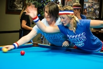Jessica Seyfried, right, and Jennifer Morash, crud players, engage each other during a spouses crud tourney, April 27, 2018, at Moody Air Force Base, Ga. The Moody spouses built the event around teamwork and comradery, giving them an opportunity to experience a long-held tradition amongst the Air Force fighter and rescue squadrons. Though the game originated in the Royal Canadian Air Force, it has since been adopted by the U.S. (U.S. Air Force photo by Airman 1st Class Erick Requadt)