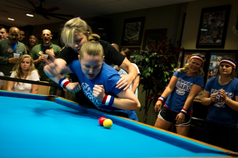 Adrianne Razack, right, and Meredith Shannon, crud players, engage each other during a spouses crud tourney, April 27, 2018, at Moody Air Force Base, Ga. The Moody spouses built the event around teamwork and comradery, giving them an opportunity to experience a long-held tradition amongst the Air Force fighter and rescue squadrons. Though the game originated in the Royal Canadian Air Force, it has since been adopted by the U.S. (U.S. Air Force photo by Airman 1st Class Erick Requadt)