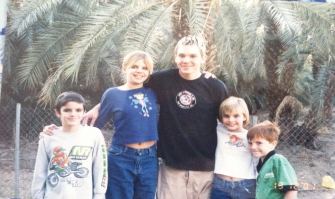 PETERSON AIR FORCE BASE, Colo. – Senior Airman Sara Welch pictured with her siblings in 2001, left to right: Darrell (9), Tara (12), James (15), Sara (8), and Daniel (6). When this photo was taken, the sisters and brothers were living in separate foster homes and were scheduled to see each other every two months. (Courtesy photo)
