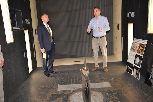 Kevin Kimmel (right), an aerospace engineer in the Sea-Based Aviation and Aeromechanics Branch, explains how the Navy™s largest subsonic wind tunnel works to Deputy Assistant Secretary of the Navy for Unmanned Systems Frank Kelley during a visit to Naval Surface Warfare Center, Carderock Division in West Bethesda, Md., on April 20, 2018. (U.S. Navy photo by Kelley Stirling/Released)
